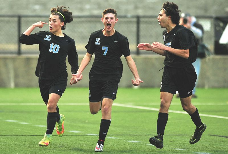 REVIEW FILE PHOTO - Lakeridge's Adam Kindorf (center) and the Pacers officially begin defense of their 2016 Class 6A state championship when fall practices begin on Monday. Also pictured here are Jonny Rodas-Hills (left) and Ari Akbari.