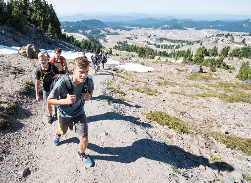 LON AUSTIN/CENTRAL OREGONIAN -  Members of the Crook County High School cross country team climb toward the summit of South Sister last Wednesday. The trip is an annual trek that is part of the team's cross country camp.