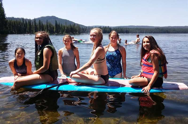 PHOTO COURTESY OF TRACY SMITH - Members of the Crook County High School cross country team relax at Little Cultus Lake following their hike to the summit of South Sister last Wednesday.