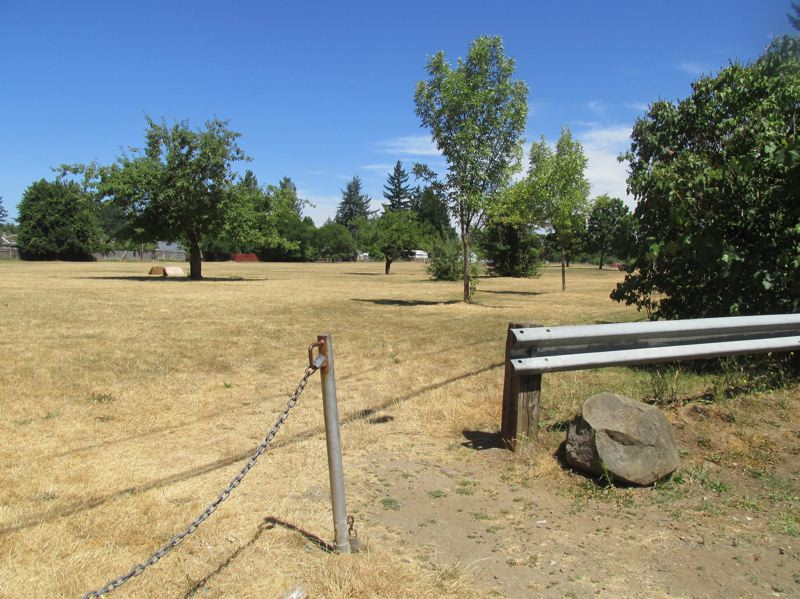 OUTLOOK PHOTO: TERESA CARSON - A no-frills entrance to Lynchview Park at Southeast 165th Avenue and Market Street. Portland Parks & Recreation has plans to transform this unused acreage into a lively park with lots of recreation features.