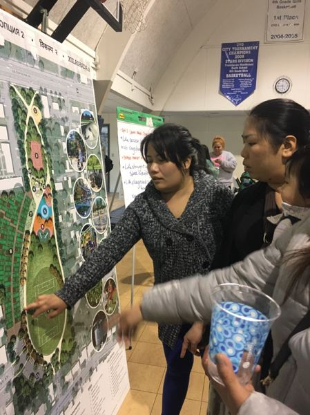 CONTRIBUTED - Community members look over some preliminary drawings of what the future 7.5 acres park at Southeast Division Street and Southeast 150th Avenue could look like. The public gave their input and Portland Parks & Rec is refining the design.