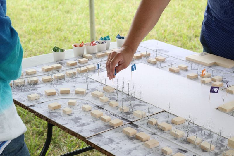 CONTRIBUTED - Community members look over some preliminary maps of what the future 7.5 acres park at Southeast Division Street and Southeast 150th Avenue could look like.
