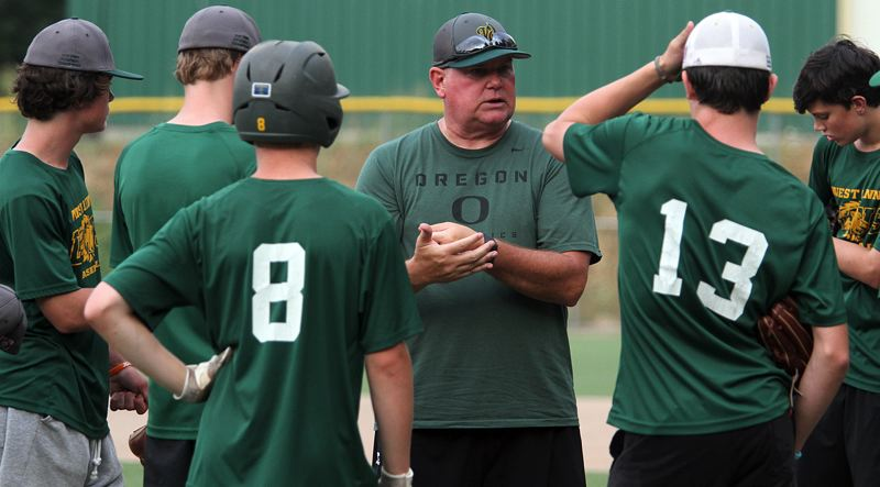 TIDINGS PHOTO: MILES VANCE - West Linn coach Ray Pearson (center) and his Babe Ruth baseball team are one of 10 teams scheduled to begin play in the 14U Babe Ruth World Series in Glen, Allen, Va., on Friday.