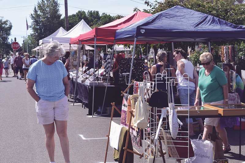 PAMPLIN FILE PHOTO - Check out the dozens of vendors in the street fair on Saturday, which shuts down many Aurora streets.