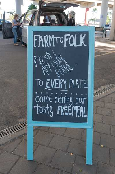 The Farm to Folk sign brings people to the table.