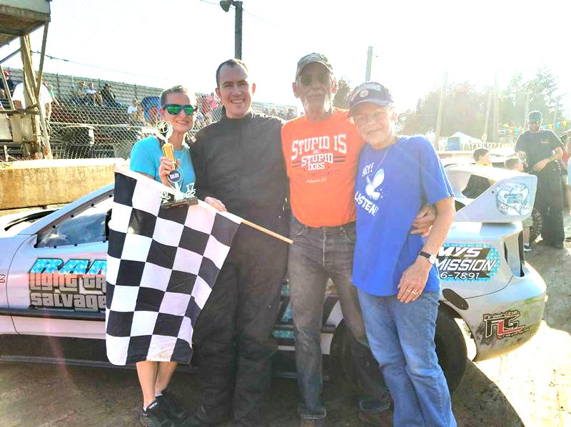 PHOTO CREDIT: L.A.B. PHOTOGRAPHY - Second from left, TJ Wegner of St. Helens celebrates his third Columbia County Racing Association Four-Cylinder main event win in a row with, from left, his wife, Shelby, his father, Lloyd, and his mother, Sandy, on Saturday, Aug. 5, at the River City Speedway in St. Helens.
