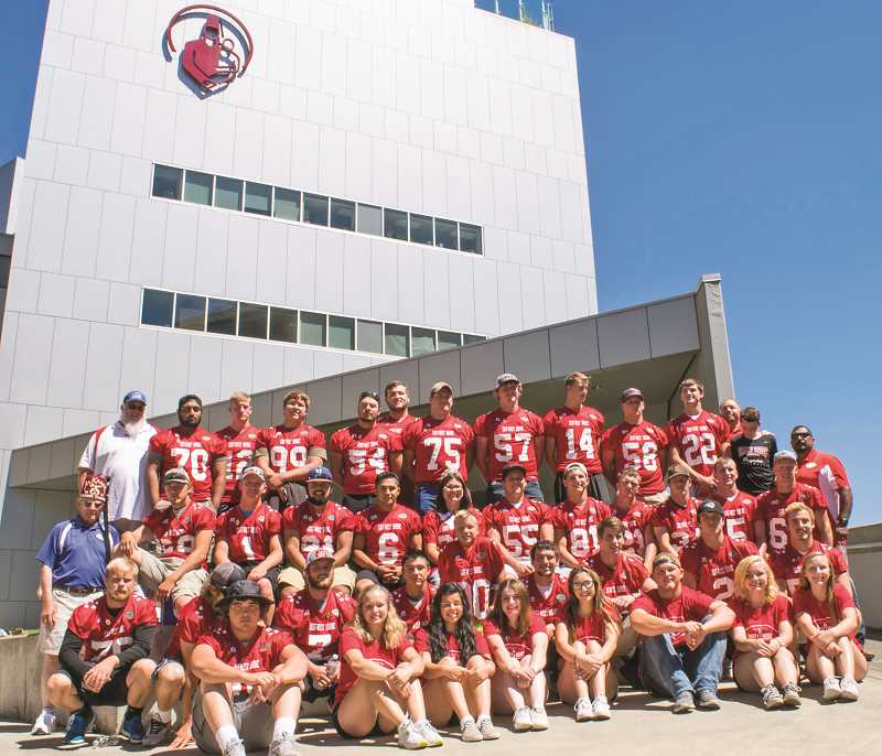 SUBMITTED PHOTO - Graduated Culver football senior Mack Little (top row, No. 58) represented the Bulldogs at the East-West shrine game Aug. 5 in Baker City, playing an active role for the East team as a linebacker, while also handling extra-point kicking duties. The East team prevailed 29-23.