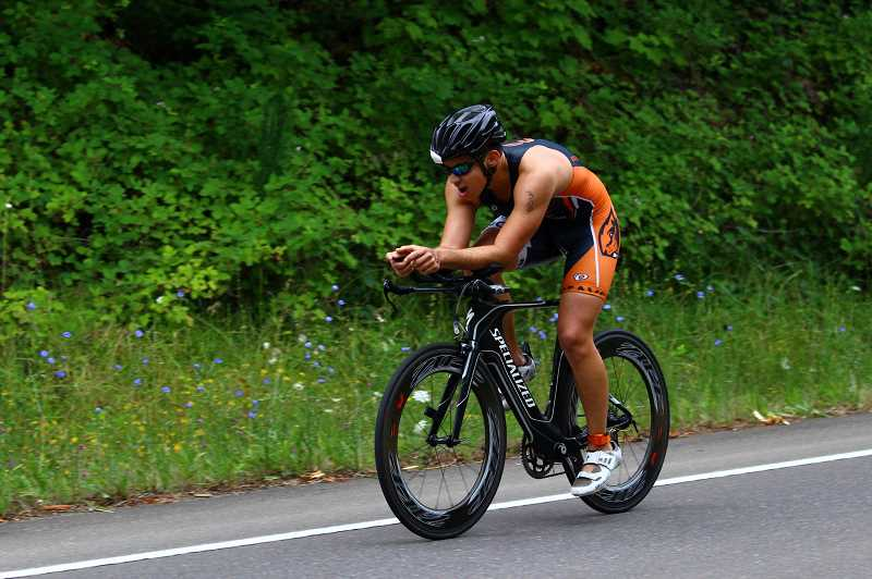 COURTESY PHOTO - Forest Grove High School and Oregon State graduate Marco Ramirez bikes during the second stage of a triathlon.