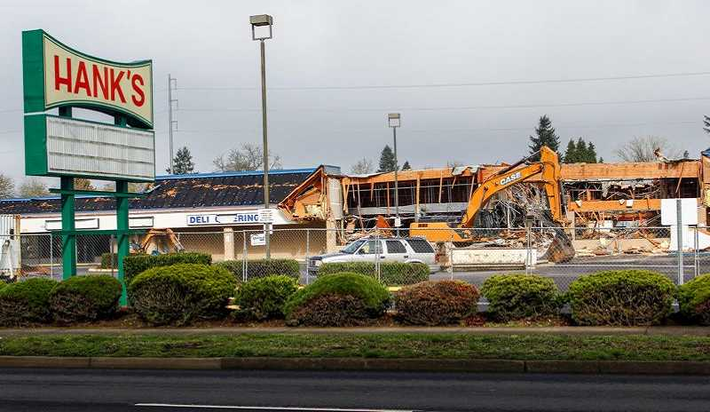 HILLSBORO TRIBUNE FILE PHOTO - Crews tear down Hanks Thriftway in February. The block where the grocer once stood will eventually become a mixed-use development with housing and possible retail, lodging or grocery components.