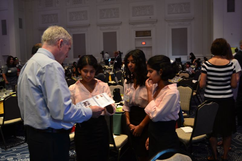 PAMPLIN MEDIA GROUP: JULES ROGERS - Pamplin Media Group president Mark Garber networks with Westview High students from nonprofit Stem4Girls, whose E-Cybermission team is a 2017 national finalist.