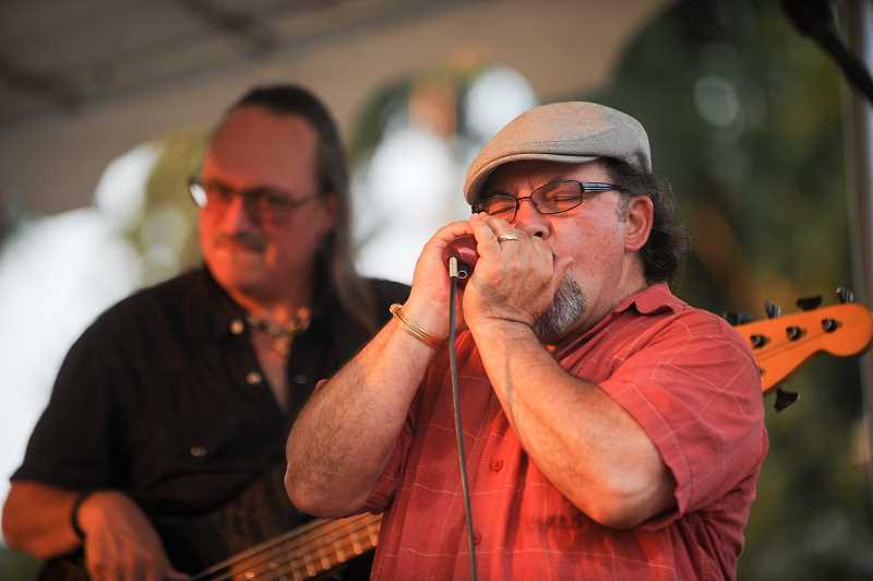 OUTLOOK PHOTO: JOSH KULLA - Singer and harmonica player Franco Paletta rocks out Monday night at Gresham's Arts Plaza as part of the city's summer music series.