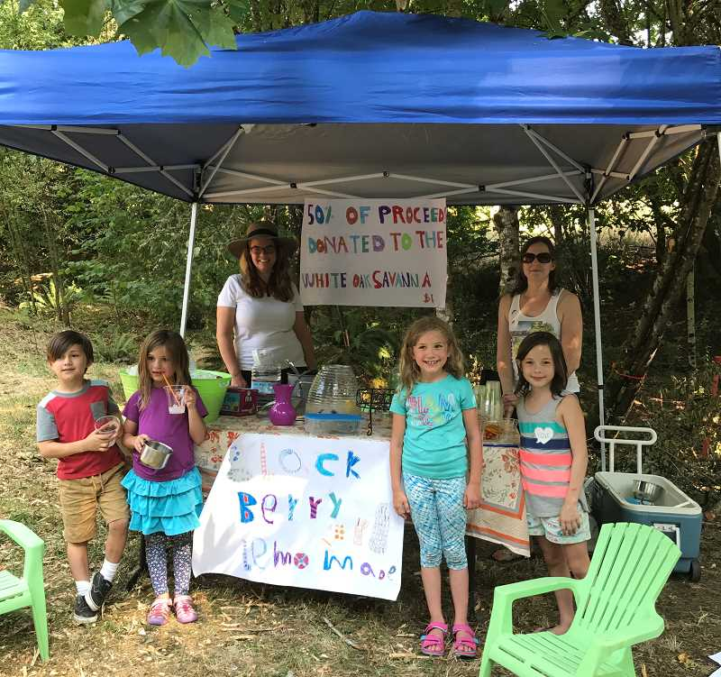 TIDINGS PHOTO: PATRICK MALEE - From left to right, Nara Rossington, 6; Phoebe Olenginski, 5; Juliet Ole, 7; and Kesavi Rossington, 8; sold lemonade to benefit the White Oak Savanna Aug. 3.