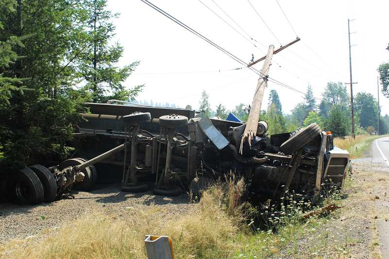 PIONEER PHOTO: KRISTEN WOHLERS - The power line was still live after the crash Wednesday near Meadowbrook.