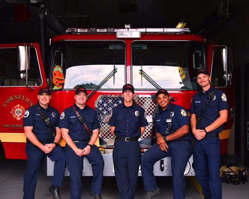 COURTESY OF ILA BORDERS - Former professional baseball pitcher Ila Borders, center, is now a firefighter and shift paramedic with the Cornelius Fire Department.