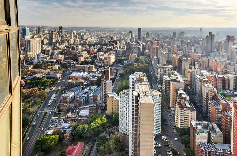 SUBMITTED PHOTO  - Elmer Galbi will talk about investment opportunities in China, Russia and South Africa from 10 a.m. to noon on Aug. 16. He will share behind-the-scenes information about investing in these countries. Pictured is the skyline of Johannesburg, South Africa.