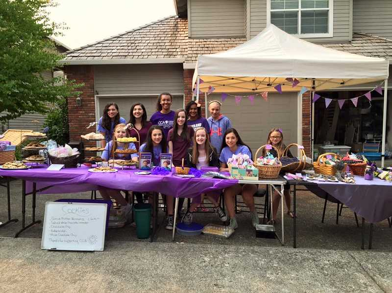 SUBMITTED PHOTO: MICHELLE BOMBET-MINCH - A group of the Lavender Girls, originals and new members, sell their wares outside the Hennings home in West Linn.