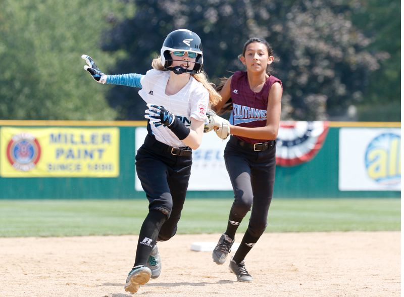 TIMES PHOTO: JON HOUSE - District 4s Hailey Stutzman is caught in a pickle against the Southwest Team.