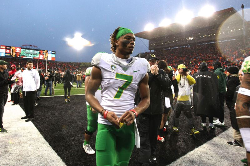 TRIBUNE FILE PHOTO: JAIME VALDE - Darren Carrington walks off the field at Reser Stadium after what would be his final game as an Oregon Duck, a loss last year to Oregon State.