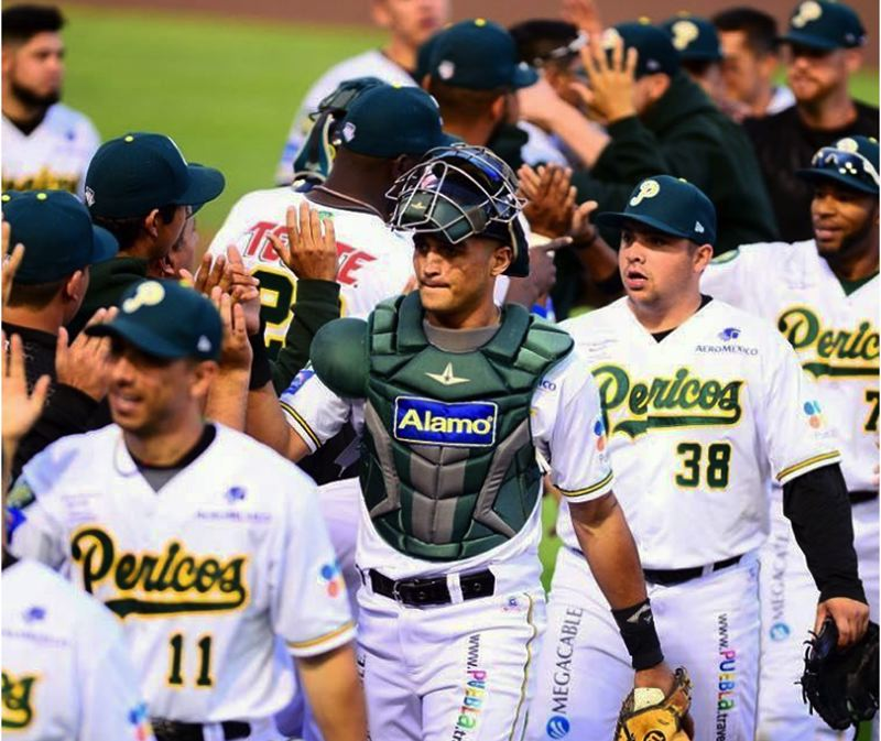 PHOTO COURTESY OF T.J. PRUNEDA - Tigard High School graduate T.J. Pruneda (38) celebrates with his Pericos de Pueble teammates following a victory in Mexican League play earlier this season. Pruneda is a left-handed pitcher, coming out of the bullpen, for the team.