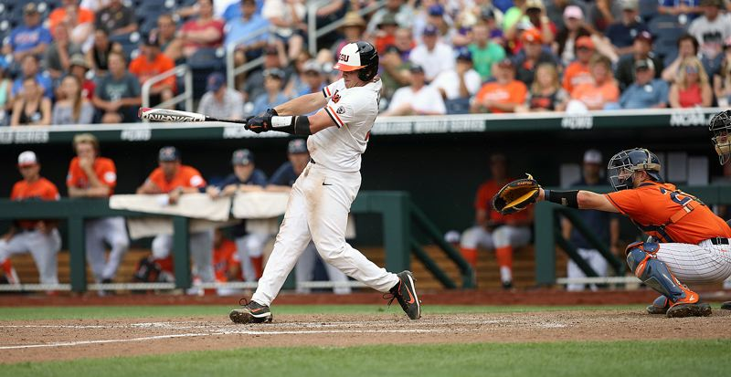 SCOTT CASSIDY: FOR THE TIMES - Adley Rutschman, a 2016 Sherwood High School graduate, drove in the game-winning run for the Oregon State University baseball team in a 6-5 win over Cal-State Fullerton at the 2017 College Baseball World Series.