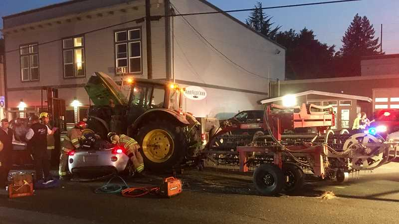 COURTESY PHOTO - A total of about 40 rescue personnel worked to safely remove two people from beneath a tractor Wednesday, Aug. 9.