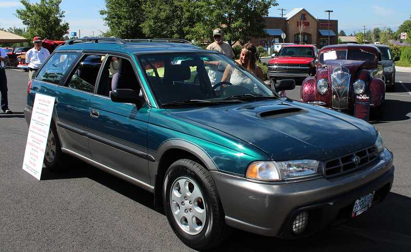 HOLLY SCHOLZ/CENTRAL OREGONIAN   - Kasiah Childers gets her first look at her first car, a 1998 Subaru Legacy Outback.