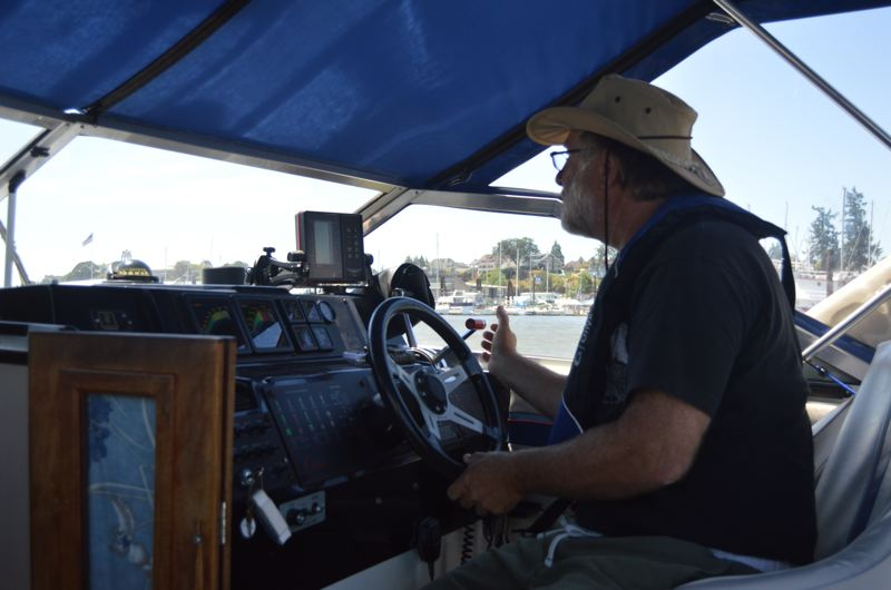 SPOTLIGHT PHOTO: NICOLE THILL - St. Helens boater Dan Sternadel drives his boat across the Columbia River to visit Sand Island. Sternadel said he has had encounters with pirate boaters before and they often make his fiance feel uncomfortable, especially in isloated places like the island.