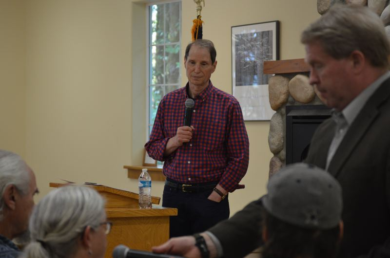 SPOTLIGHT PHOTO: NICOLE THILL - U.S. Sen. Ron Wyden speaks during a town hall meeting in Vernonia on Tuesday. Aug. 8. Audience members asked a wide range of questions on topics like immigration reform, care for veterans and national policies.