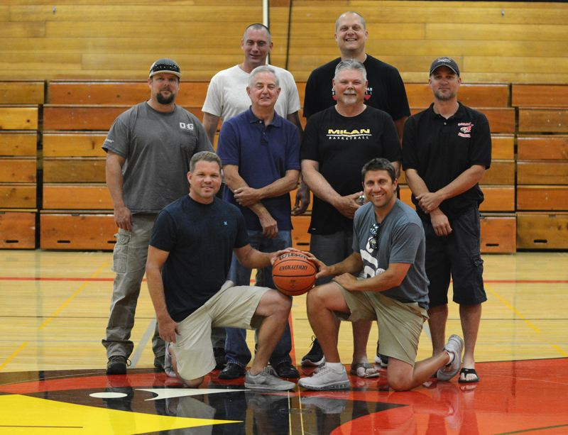 OUTLOOK PHOTO: DAVID BALL - Members of Corbetts back-to-back championship teams in 1994 and 1995 gather at center court of the gym that used to be standing-room only to watch them play.