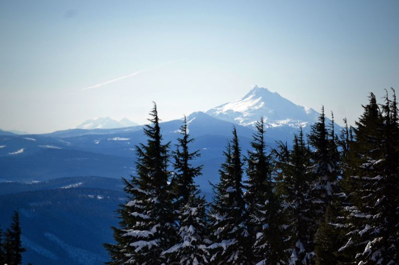 FILE PHOTO - The mountain looms over snowy evergreen trees in the Mt. Hood National Forest.