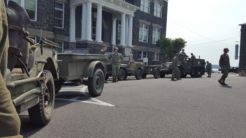 THAD SMITH PHOTO - Restored WW II military vehicles line the Columbia County Courthouse plaza as they gear up to head to Scappoose Saturday, Aug. 5.