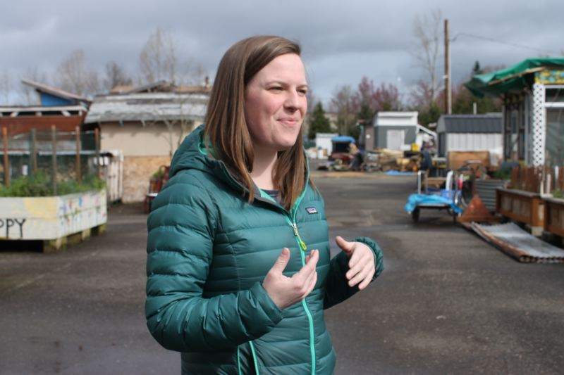 TRIBUNE PHOTO: LYNDSEY HEWITT - Katie Mays, who is employed by JOIN, works on site at Dignity Village.