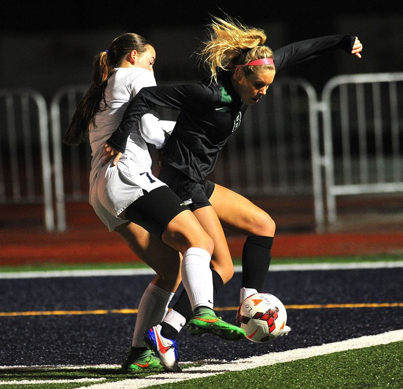 TIDINGS FILE PHOTO - West Linn's Abby Gross (right, shown here against Lake Oswego last year) and the Lions begin tryouts for fall season at 4 p.m. Monday at Rosemont Ridge Middle School.