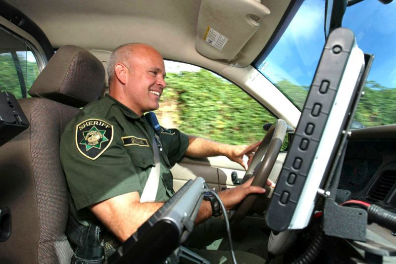 FILE PHOTO - A Multnomah County Sheriff's Deputy smiles at work.