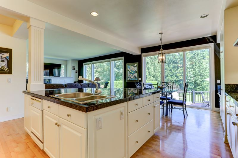 COURTESY PHOTO: LEGACY REALTY GROUP - A giant kitchen island provides plenty of space to chow down and enjoy the scenic views of southwest Gresham's forested buttes.