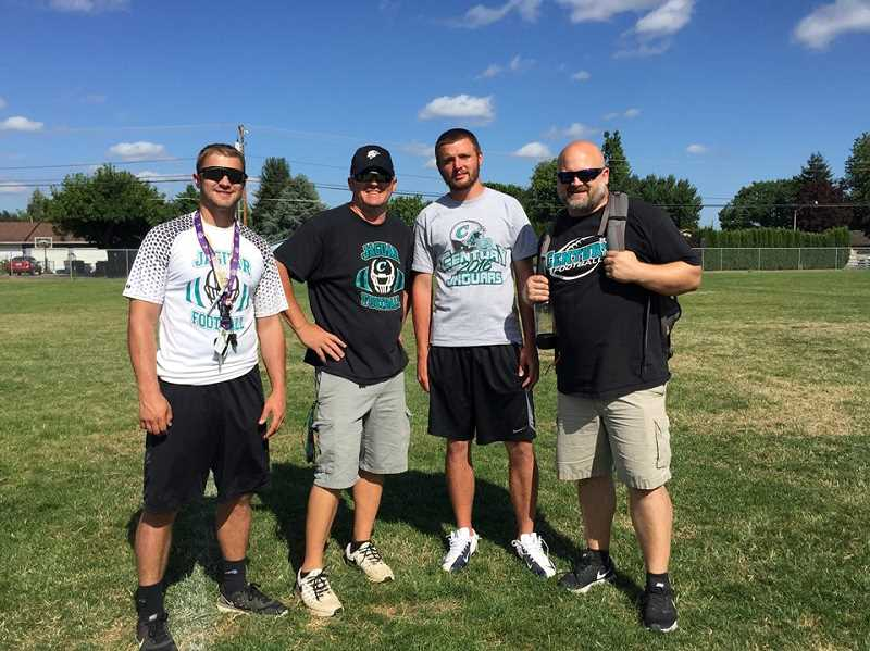 COURTESY PHOTO - Century coaches gather for a picture at the Linfield team camp last month at Linfield College in McMinnville. (Left to right: QB Coach Tyler Harper, Sean McMenomy, WR Coach Danny Kernan, Defensive Coordinator Aaron Nave)