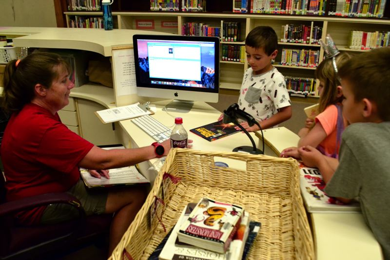 POST PHOTO: BRITTANY ALLEN - For five years, Burden has devoted her summer Wednesday afternoons to allowing children access to the Kelso Elementary School library.