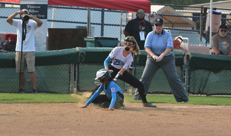 TIMES PHOTO: MATT SINGLEDECKER - South Beaverton third baseman Chloe Arbow puts down a tag on an Asia-Pacific player.