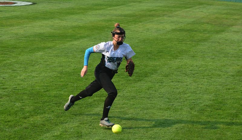 TIMES PHOTO: MATT SINGLEDECKER - South Beaverton outfielder Alaina Baseleon chases after a ball against Asia-Pacific.