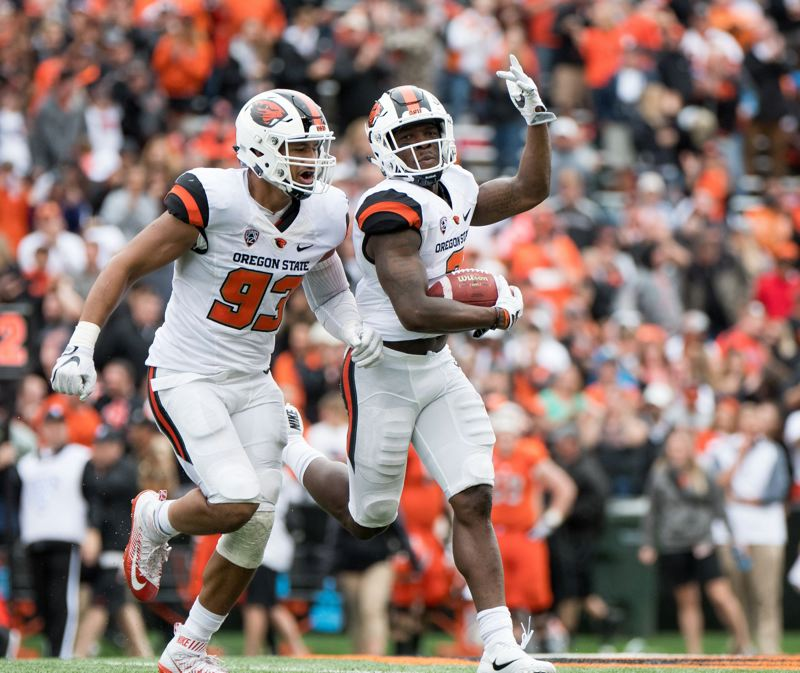 TRIBUNE FILE PHOTO: JOSH KULLA - Brandon Arnold (right) celebrates an interception last season for Oregon State.