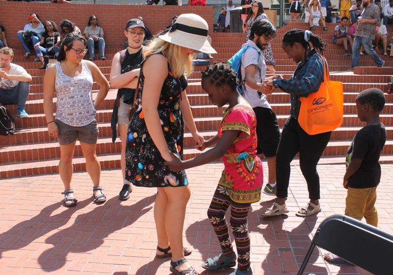 TRIBUNE PHOTO: LYNDSEY HEWITT - People danced at the first Pan African festival on Saturday, Aug. 12.