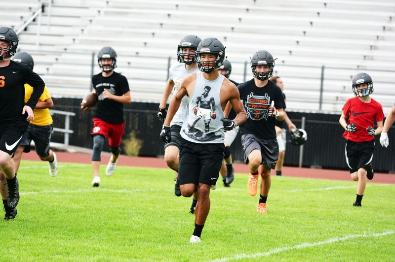 SPOTLIGHT PHOTO: JAKE MCNEAL - From left, Jerad Toman, Mason Smiens, Tevin Jeannis, Tristan Miller and Thomas Greiner run sprints on the first day of practice at Scappoose High School.