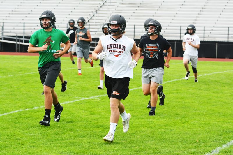 SPOTLIGHT PHOTO: JAKE MCNEAL - Foreground, from left, Ross Parsons, Jimmy Jones and Andrew DeGrande run conditioning drills.