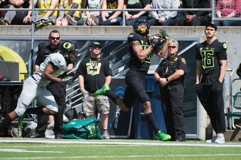 TRIBUNE FILE PHOTO: CHRISTOPHER OERTELL - University of Oregon receiver Dillon Mitchell goes deep for a pass during the spring game at Autzen Stadium.