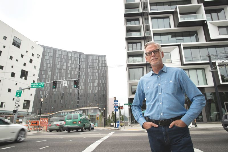 PAMPLIN MEDIA GROUP: JAIME VALDEZ - David Wark, chair of the citys Design Commission, oversaw buildings behind him —the Fair-Haired Dumbbell, the Yard and the Slate — in Southeast Portland.