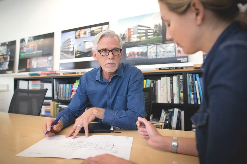 JAIME VALDEZ - David Wark, AIA principal architect at Portland-based Hennebery Eddy Architects, works with associate Dawn Carlton on project. Wark is chair of the citys Design Commission.