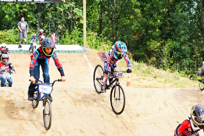 SPOTLIGHT PHOTO: JAKE MCNEAL - Lucas Cardona (535), 12, and Geoffrey Worlitz (318), 5, won their respective 12 Novice and Cruiser divisions at the Columbia River BMX Race for Life on Saturday, Aug. 12, at the Phillip S. Barlow Memorial BMX Track at McCormick Park in St. Helens.