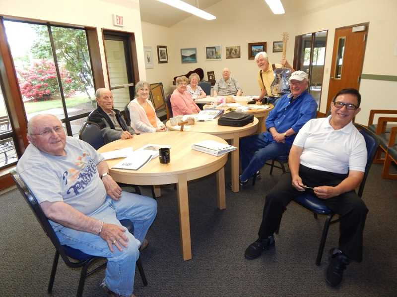 SHERWOOD GAZETTE PHOTO: BARBARA SHERMAN - On a summer Wednesday morning, a group of writers at the Sherwood senior center included (from left) Duane Owens, Peter Aloia, Jeanne Aloia, Anne Poe, Marilyn McDowell, Leonard Whitlaw, Jeff Andrew, Tommy Moore and Tony Nunez.
