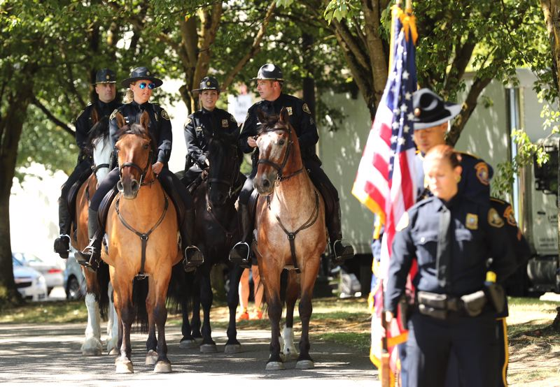 PAMPLIN MEDIA GROUP: JAIME VALDEZ - A ceremony Wednesday, Aug. 16, marked the official end of the Portland Police Bureau's Mounted Patrol Unit.