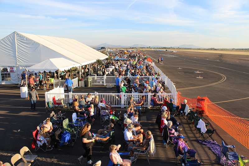 HOLLY M. GILL - Crowds watch the start of the 2016 Airshow of the Cascades, which drew more than 15,000 people to the Madras Municipal Airport. This year's event is scheduled for Friday and Saturday, Aug. 25 and 26.